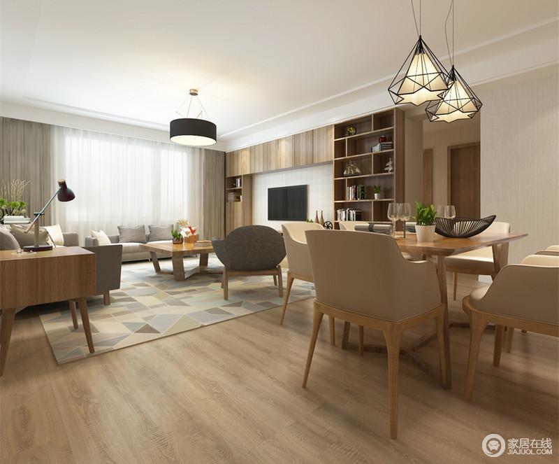 餐厅与客厅的通透性使空间显得开阔舒朗,简洁朴质的木质散发着自然的润和,彰显出舒适的森系情调;悬挂的铁艺灯饰,线条感强烈,为空间点缀出一丝硬朗的工业风。