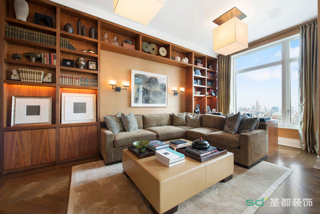 客厅的另外一角隔断,设计成简单的书房,但又显得大方得体,和整个客厅融会贯通。