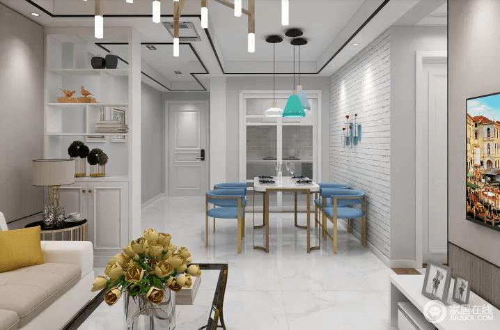 客餐厅以白色文化砖铺贴餐厅的墙面,营造一种纯净、无杂乱的视觉效果;厨房处的玻璃门简单分区,并以浅灰色墙与白色木门建立层次与造型之美,使素雅而通透;蓝色凳子与大理石面的餐桌因为黄铜质地尽显奢华,给客餐厅营造出一种眼前一亮的感觉。