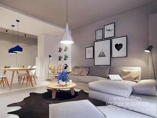 客厅运用灰色粉刷墙面,搭配柔软的灰色沙发却在黑白装饰画和黑色皮毛地垫的点缀中更显时尚;空间色调的纯净愈显安谧,淡色实木茶几的简约与黑白灯具彰显着北欧之光,令空间愈显舒适。