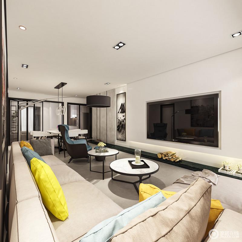 客厅的背景墙十分流畅简约,电视被嵌入墙面,形成黑白艺术画的格调,减少了冗余;黑白圆几的个性与蓝色扶手沙发给予空间时尚,让生活更富格调。