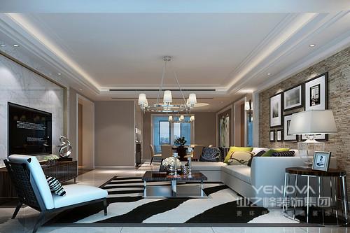 客厅以驼色为主,但是通过不同材质的组合塑造了一个视觉效果丰富的空间,从大色大理石背景墙、木石沙发墙都显示着自然积蓄的天然生机;黑白地毯魔化了空间,而彩色靠垫亮点了沙发,庄雅而静致。