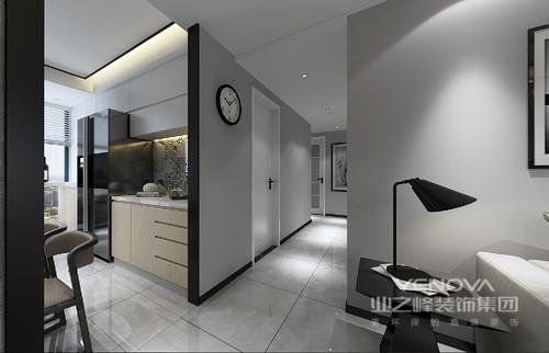 客厅整体感觉干净利落,灰色背景墙的黑白摄影作品格外抽象,浅灰色沙发、黑色方几协调出空间的简约和大气。