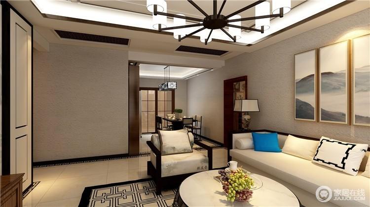 客厅以驼色壁纸来增加空间的朴素,与米色地砖构成中性大气;新中式沙发的新雅和陶瓷台灯的古典气质,让你回味东方艺术对生活品质的提升。