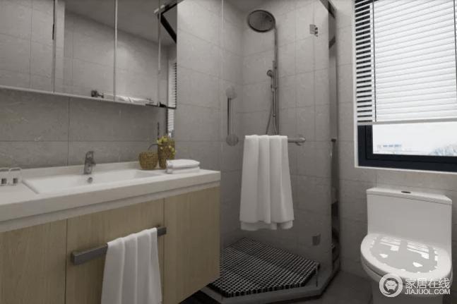 卫生间采用了浅灰色的地砖和墙砖来铺贴空间,素静之余,空间更为利落;转角做成淋浴室巧妙增强了空间,同时,借镜面玻璃柜和盥洗台以实用之能,让生活更为便捷。