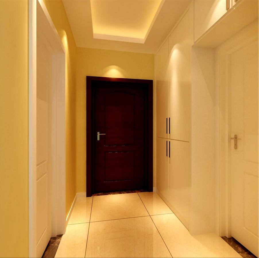 入户走廊上,设计师将玄关柜内嵌入墙,使空间规整利落的突显出简洁感;鹅黄色的墙面与白色的房间门及壁面柜,在点光源的布光下,盈满轻盈温馨的舒适惬意;红木大门,则鲜明的展现出视觉层次。