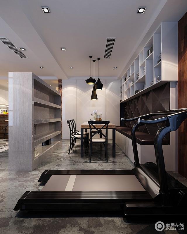 客厅与餐厅通过一扇石墙分隔,空间分明,功能有序;地砖的深沉让空间多了工业冷冽,而白色收纳柜和悬挂柜强化了空间的实用性,同时让原本高冷的空间,多了明快,让生活更为畅快。