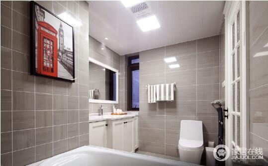 卫生间在色调上选用了浅灰墙砖来铺贴墙面,而白色盥洗柜、白色木框镜子和白色浴缸与之搭配出一种安静、素雅;毛巾架的实用,挂画的雅致,留动着简洁艺术,却实用有致。