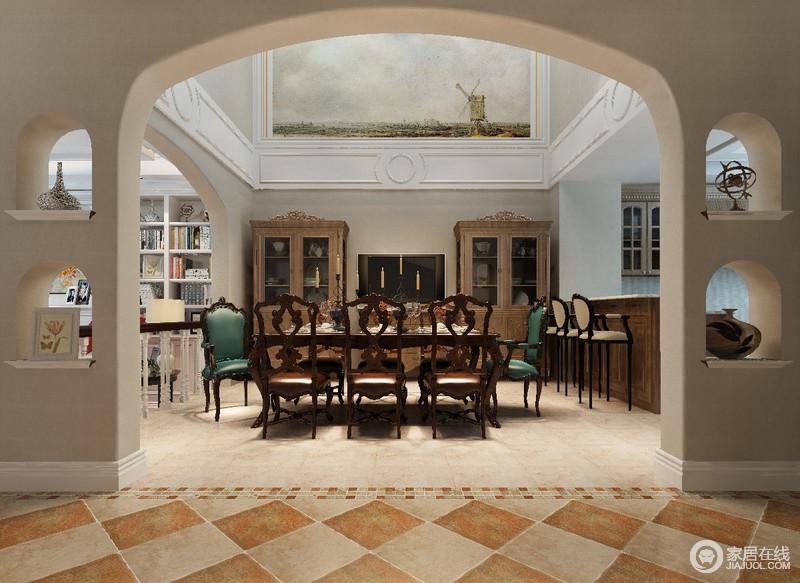 装饰性的拱形门洞和地面材质的拼接,优雅划分空间区域;拥有挑高空间的餐厅,分别通过扶栏与休闲吧台,作为区域间的划分,空间与空间井然有序且隔而不断;餐厅内灰墙打底,深木色餐桌椅与酒柜材质相同,两把孔雀绿座椅,凸显就餐主位。