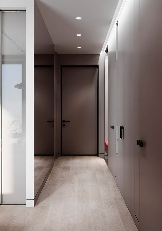 玄关一旁的镜墙扩大了视觉面积  上方的一排顶棚灯简约大方