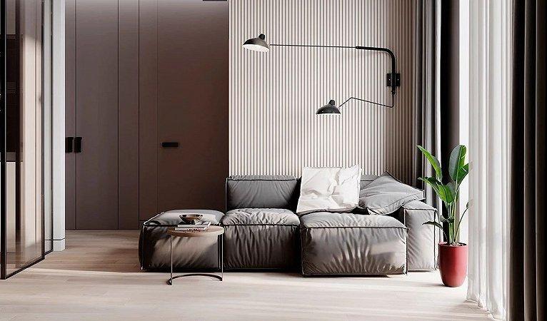 客厅的部分由于空间不大  所以较为简洁  灰色的布艺沙发上方一体式的两盏壁灯  拥有两种照明方式且独具美感