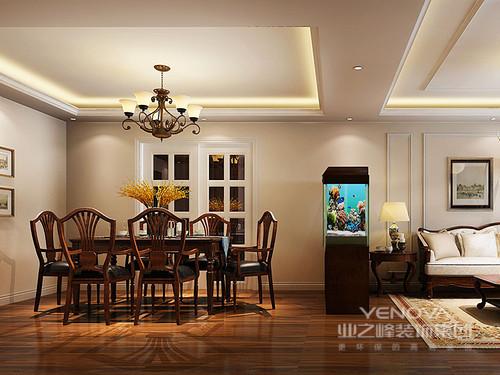 餐厅与客厅通过水族箱划分,墙面从客厅延展过来,形成视觉上的统一感;厨房的白色格子玻璃门,与客厅简约的石膏线呼应;方形的大餐桌朴质沉稳,搭配温莎椅造型的餐椅,复古的优雅彰显出来。