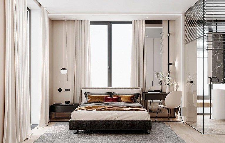 床铺和地毯都用了灰色  配上金色的枕套  增加了一丝轻奢的气息
