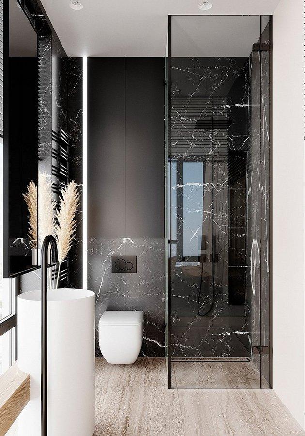主卧的卫生间也由黑白棕组成  小小的空间也做了干湿分离  木纹的地砖和麦穗装饰物  让这片天地充满自然气息