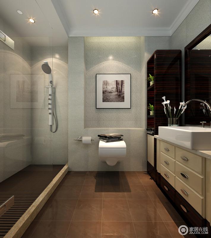 卫浴间设计十分紧凑,因空间布局的原因,设计师将盥洗台和淋浴区相对而置,干湿分区明显;利用白色立面与大地色的地面形成对比,艺术画恰当地将艺术气息蔓延在空间,更显雅致。