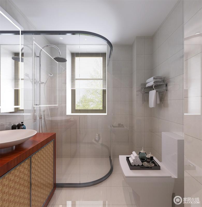 卫生间采用清新干净的米白色方块大理石铺贴,显得清爽简洁;弧形的玻璃隔离出干湿区,易于空间上的清洁打扫;红木制的盥洗柜,柜面以编织纹装饰,营造出几分自然感;台面上白色的面盆,盆口开阔,便于日常梳洗。