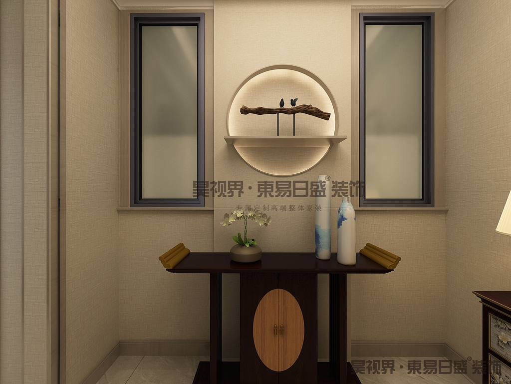 """入户玄关的位置,一进门就能看见一个""""中国圆"""",加上木头的点缀和一个翘头案,使玄关更有禅意。"""