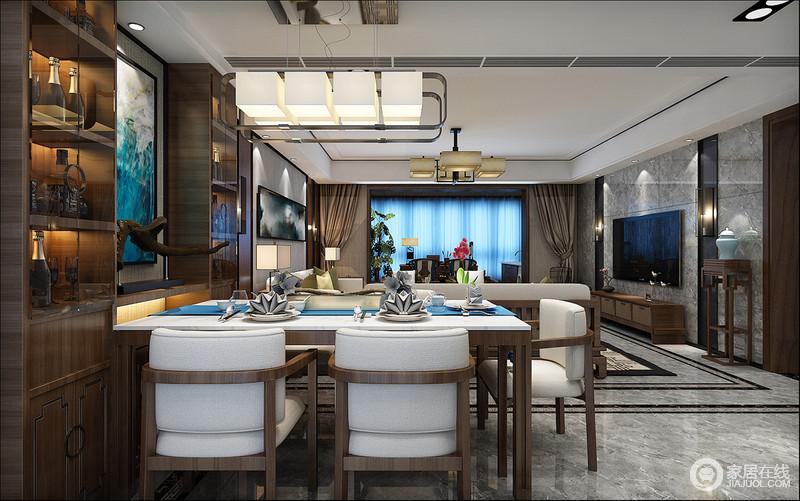 客餐厅浑然一体,通体灰色的地砖让整个空间素静了不少,餐厅内的酒柜足以体现主人的喜好,而与之呼应的新中式餐桌餐椅带着时尚,与水晶灯的璀璨,让用餐也变得温馨而有现代质感。