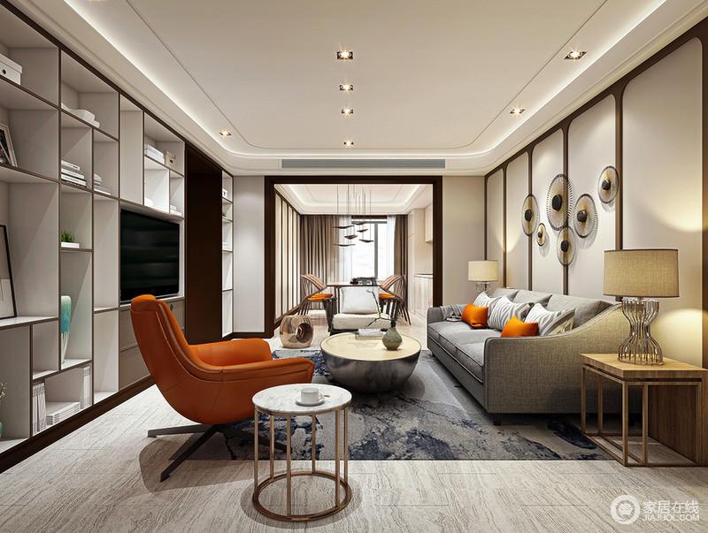 客厅以椭圆形吊灯减去棱角的硬朗,并与射灯增加空间的柔和,背景墙的几何块在圆形饰品的装饰下,平衡出精致;灰色沙发因墨兰地毯和造型迥异地家具组成现代时尚,设计师巧妙地以几何书柜增加空间的实用之能,尽显生活哲学。