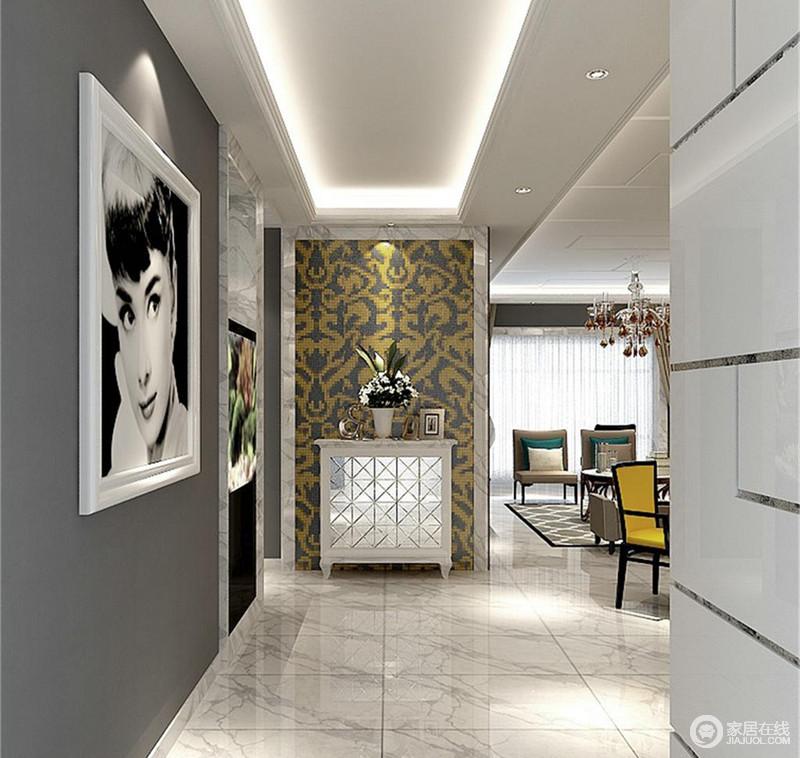 玄关的地面和墙面及边柜,均采用干净的白色调和深灰色,而不同肌理和线条的交错,丰富了空间视觉,也愈加凸显出黄色马赛克花纹背景墙的动感;动人的花纹与赫本黑白人物装饰画,带来多元多彩的艺术气息。