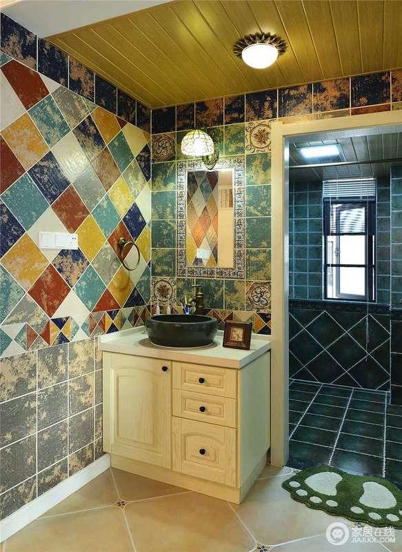 卫生间分区的设计让生活更为舒适,墨蓝色的砖石让淋浴室更为耐脏;盥洗区颇有民族风情的砖石以菱形的方式凸显墙面的动感,让空间多了时尚,也更为明媚斑斓。