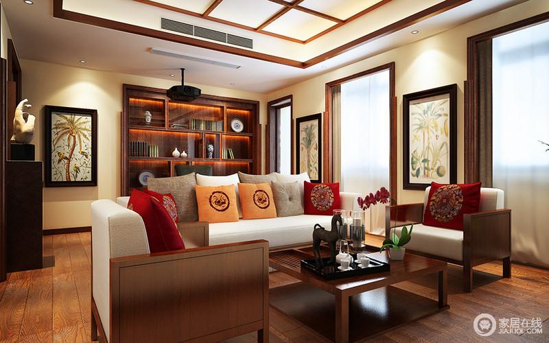 客厅并没有作单一性设计,而是将书柜嵌入墙体,增加空间的功能性和文艺气息;米色漆与原木地板简单却让空间洋溢着和暖,新中式实木沙发,因为红色和黄色的靠垫,多了色彩之余,更张扬中式时尚,茶几的木楞设计简雅大气,满是古韵新美。