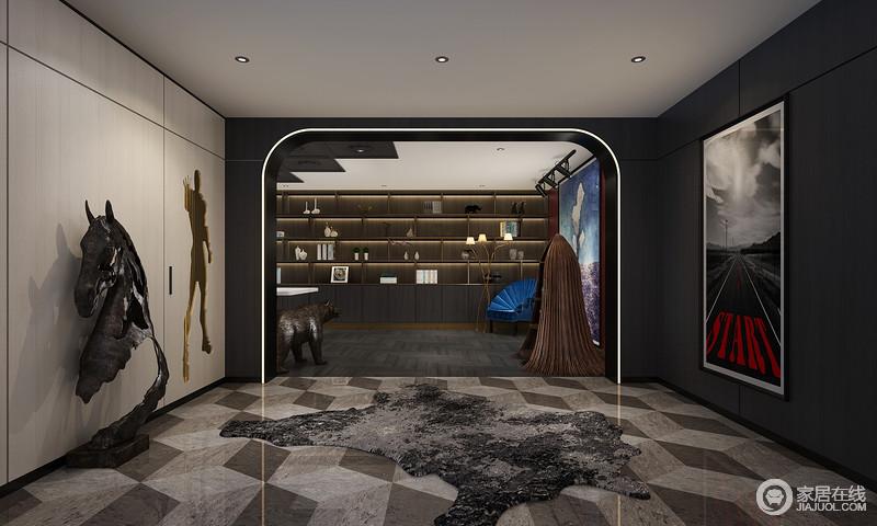 合理的空间布局,充分利用了空间资源,为户主不仅提供娱乐化的空间,更完善了户主对工作空间的需求;再加上灰色菱形几何地毯,给予空间素静,同时,也与书柜构成空间的动律。