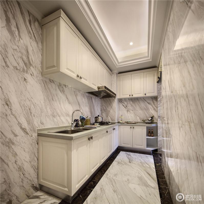 厨房以白色为主基调,L形的橱柜设计让整体效果现代大方。