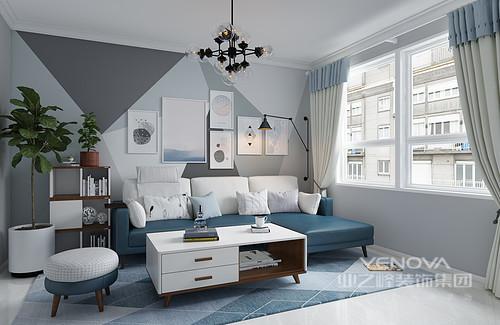 以灰色调为主的客厅,墙面以绒灰为背景色,蓝色做为点缀,跳色的使用让室内整个空 间内不沉闷,白色的收纳茶几和边几解决了客厅杂乱物件的收纳,简洁明快贯彻在整间房间的每个细节。