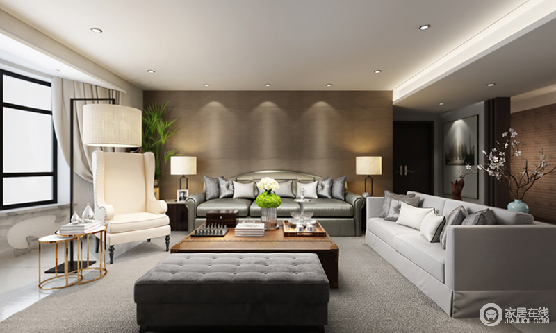 客厅的沙发背景墙以褐色板材来装裱,因为方形边柜、两盏台灯的对称摆放多了和谐感;以深浅不一的灰色地毯、沙发来彰显现代素静,而银色现代古典沙发却颇显尊贵,美式扶手椅旁的黄铜圆几带着时尚,让空间更具包容性,也张扬着生活的质感。