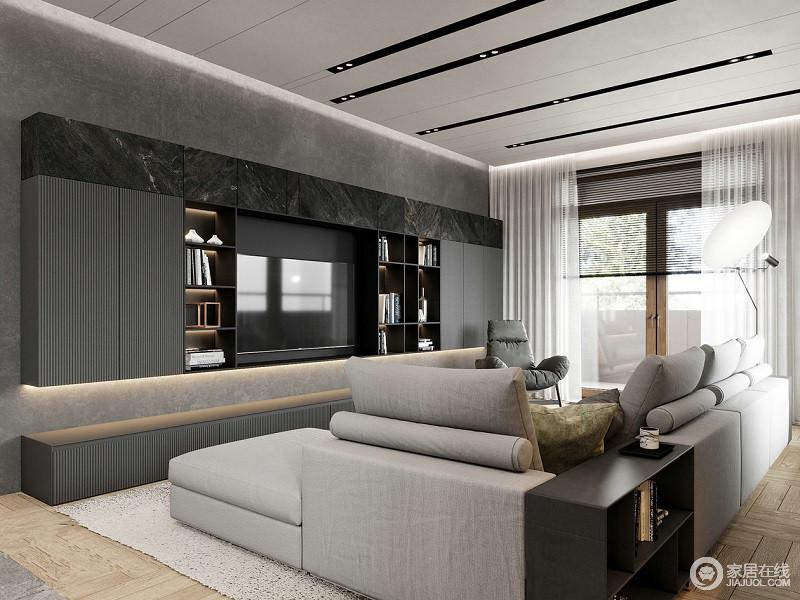 客厅以黑白灰三色为基调的搭配,奠定空间的沉静,整体空间以线条凸显空间的利落;电视背景墙嵌入式收纳设计,因为大理石材质,更显精致。