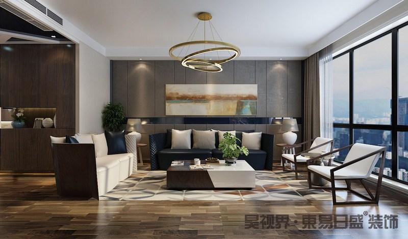 客厅因原木地板铺贴出自然朴质,灰色软包沙发背景墙的线条处理带来了简洁,而抽象地挂画为空间注入色彩,低调中散发艺术生机;黑白组合的沙发造型优美、质感考究,与创意十足地实木扶手椅呈现代时尚,茶几实木拼色设计与单椅一脉相承,同时,呼应着圆几和台灯,让空间现代温和。