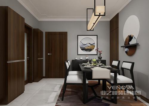 客厅空间延续门厅的胡桃木主色调,将现代元素和中国传统元素相结合,体现了中国式的古典之美;用色上以浅灰色为主,搭配原木之色,展现了新中式设计的沉稳和大气。