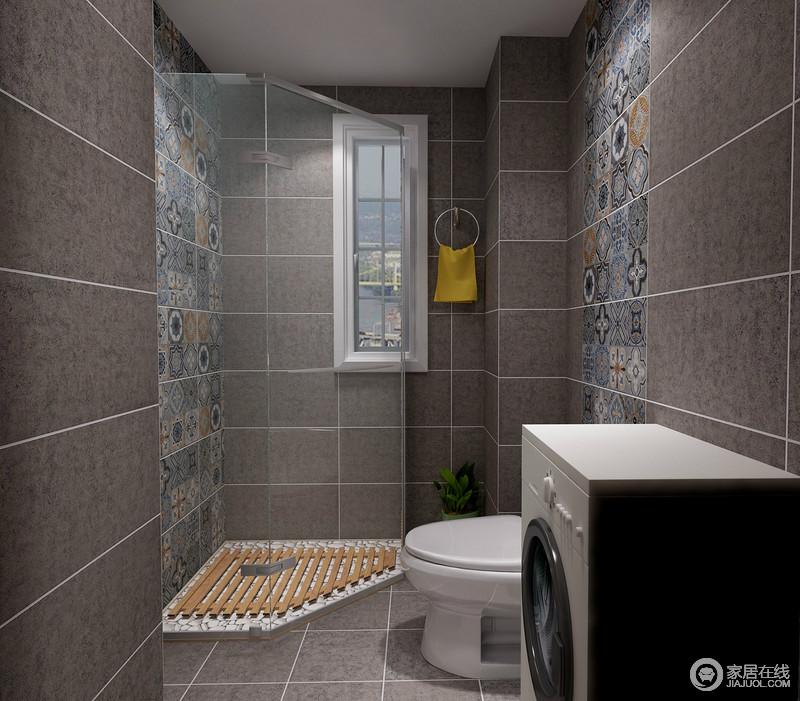 卫生间以深灰色的砖石铺贴空间,营造了沉静与暗抑的美,彩色花砖的点缀,让空间多了时尚和异域特色;淋浴室的防滑设计更为人性,让沐浴的安全系数也提高了不少。
