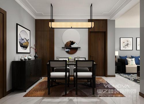 餐厅空间作为整家中的主动线,承担着入户和就餐双重功能,空间内一幅精致的中式作画和悬挂式摆件,加重了空间的禅静;高挑的胡桃木护墙板与门楣呈对称设计,将不规则墙面梳理的整洁流畅,成就了空间的中式稳重。