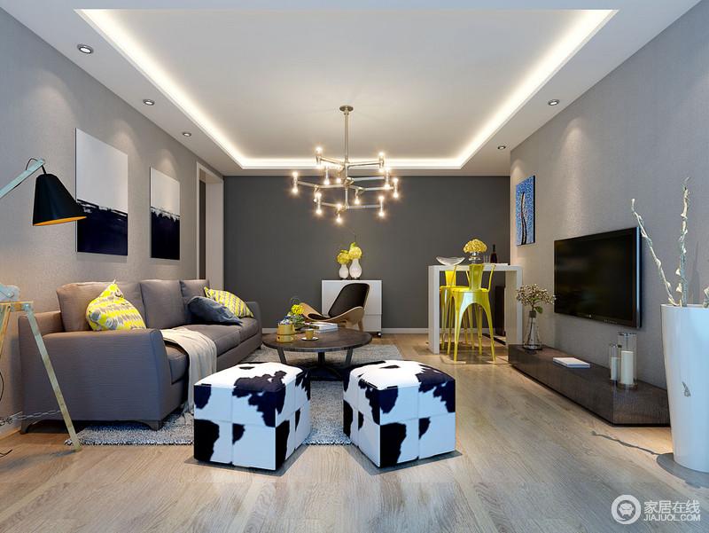 客厅线条简洁利落,灯带不仅让空间明快,还凸显出空间的几何简美,而金属吊灯的工业精致,令空间更为闪耀;墙面被粉刷成了深浅不一的灰色,层次中奠定了素静;沙发背景墙的黑白画作镌刻着抽象艺术,与牛奶纹样的坐墩延续时尚,而灰色沙发、简约的单椅、台灯平衡出美学与实用,正如白色小桌与黄色高脚凳,轻巧也实用,让客餐厅更为雅致。