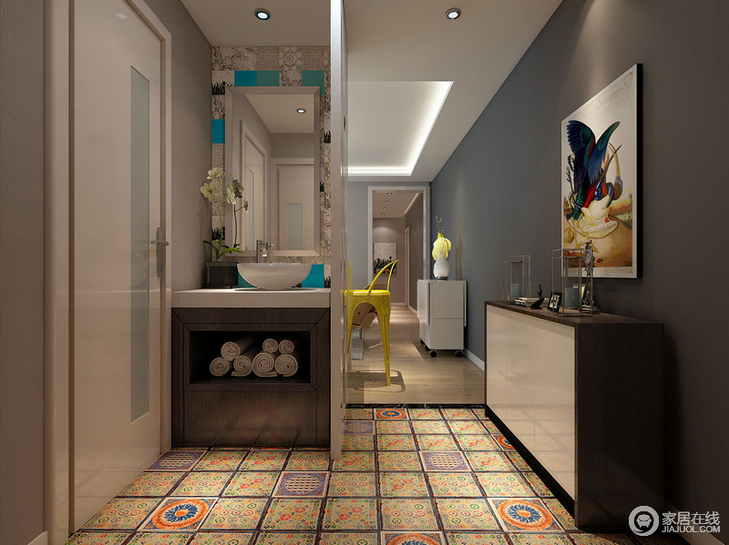 走廊因为结构的原因,设计师特地增加了盥洗区来提升生活的品质;原本空间的深浅灰色调让空间具有了素静和层次,彩色花砖带着石材的纹样与肌理让空间张扬着清新和明快,黑白色调的边柜摆放在一侧,与画作组合,协调出空间的得体与雅致。