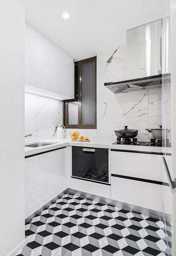 厨房通用白色材质,弱化墙面与天花,操作台与墙面的空间界限,看着很有整体感。搭配地面几何纹路地砖,时尚又炫酷。