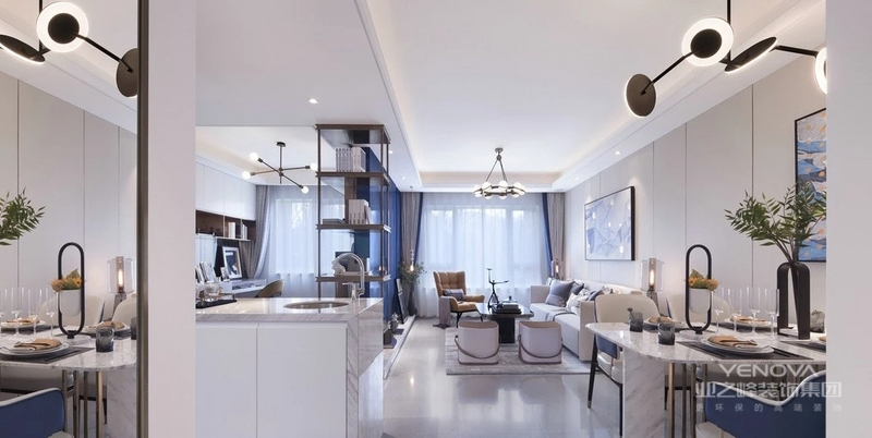 风格诠释:整个空间以白色和孔雀蓝色为基调,通过明亮的对比以及射灯的运用,营造出极简恬适的居家风格,设计师在空间也对空间结构关系做了很大的调整,增加了半开放式厨房,吧台以及中置式电视墙,让客户在繁重的工作后可以在饮食上享受到生活的情趣。
