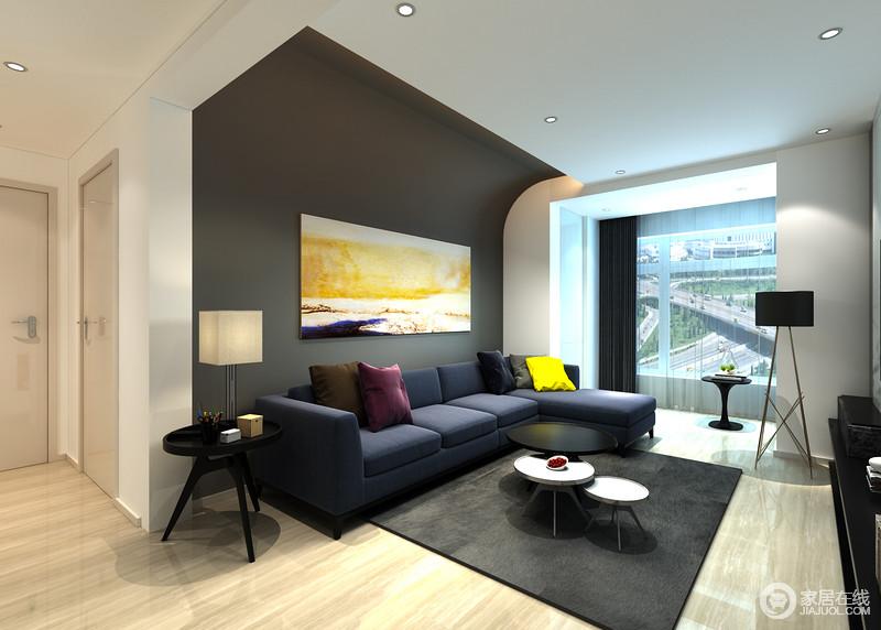 客厅以深灰色漆粉刷墙面,并延伸致吊顶一处,让空间结构造型个性,而黄色之韵的抽象挂画,渲染出简约的色彩艺术;深蓝色布艺沙发松软,黑白组合的圆几与趣意的灯具渲染出简洁与优雅。