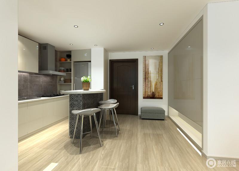 开放式的空间并非没有太强的结构感,一切从实用考量;入口区的挂画和灰色单人沙发组合出一种温情,而烤漆板嵌入墙体构成的收纳柜,满载着实用哲学,让设计更显智慧;并以灰色花形砖打造的吧台与厨房分区,而橱柜以灰色和白色组合的形式,满足实用之外的美观。