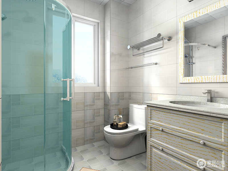 卫生间利用蓝色淋浴房将空间进行干湿分区,灰色砖石拼接式设计给予空间动律,素雅之中,更耐磨、易打理,盥洗柜的收纳功能强调了实用美学。