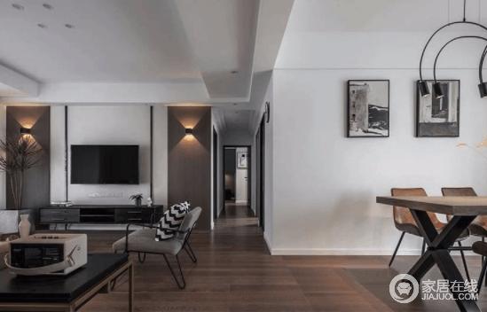 整套设计,以棕灰色搭配清爽的墙面 让所有陈设往下沉,分量感十足 墙面和天花板的白色,明暗对比,让深色空间丝毫不显压抑,走廊将空间分割开来,更具有空间艺术。