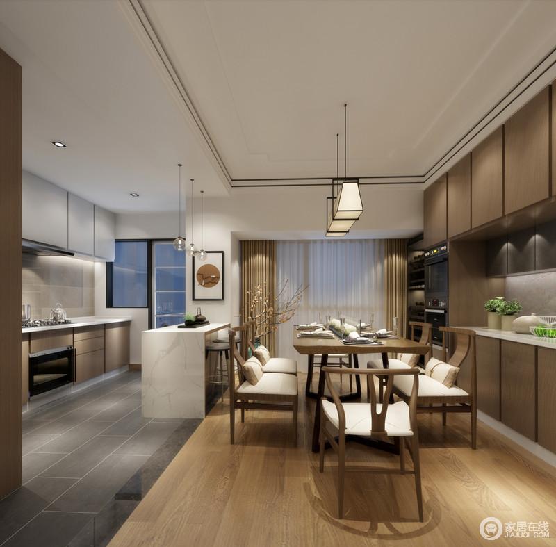 开放式的厨房与餐厅通过白色大理石吧台,冷暖拼接的地面,划分出各自空间区域;厨房主打冷色调,材质硬朗简洁;餐厅则多以成熟稳重的材质和色调设计,且古今温和混搭;空间所传递出的氛围,和谐又平衡有趣。
