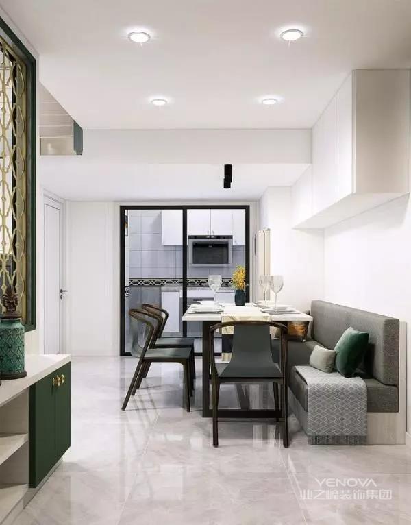 餐厅采用卡座+顶部壁柜的设计方式,充分融入收纳空间的同时,也大大节约了餐厅空间。厨房与餐厅之间采用玻璃推拉门进行分隔,避免油烟问题,也使得空间的视觉效果更加通透。