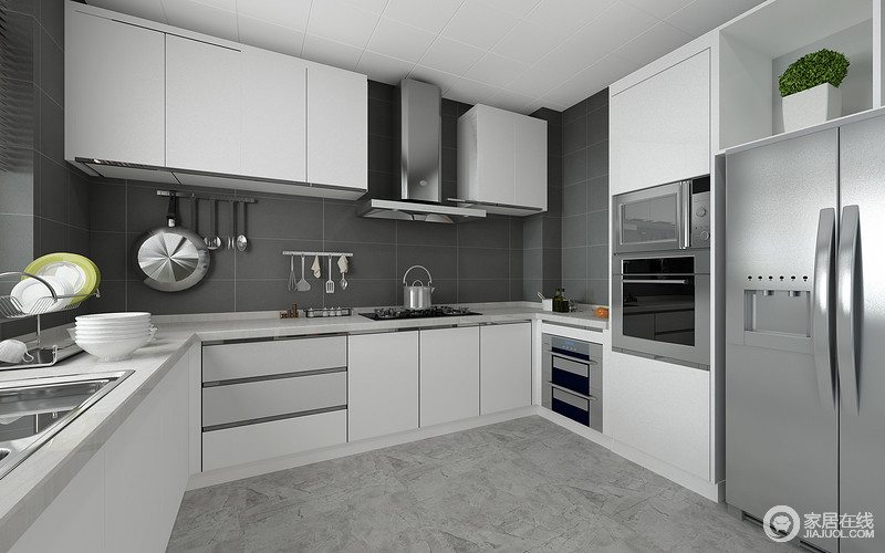 灰色的方砖铺贴背景墙,配以白色的整体橱柜,灰白色调利落的表现厨房的干净整洁;家电被巧妙的嵌入橱柜中,愈加显得空间简练规整;U型整体橱柜的设计,也为厨房带来充足的收纳存储功能。