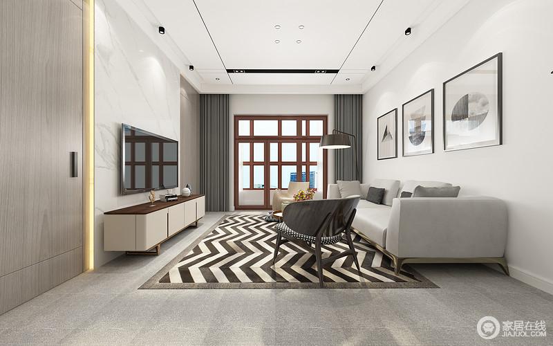 以灰白为主打的客厅中,拼色条纹地毯极具夺目的渲染气氛,为空间注入悦动活力;沙发墙上文艺画作留白点缀,电视墙则用石材拼接木质,对称中结合隐形门,让空间简约大方且不失功能性;整体黑白灰色调演绎,诠释出灵动雅致。