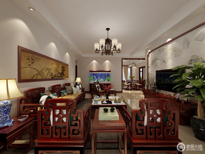 客厅内的红木家具带着东方传统的印记,沙发上的中式造型设计赋予了空间中式文化,同时,也延续了踏实和稳重;青花瓷台灯对称的方式陈列出了和谐,与挂画的棕黄色复古,给空间造就色彩的跳跃。