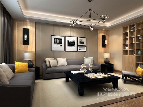 客厅结构规整,设计师以驼灰色皮包背景墙让线条的简洁带你感受简约艺术,黑白之调的摄影作业,让你体味文艺;灰色沙发和黑色实木茶几在驼色地毯和博古柜的装饰中,多了雅韵,生活也变得温和。
