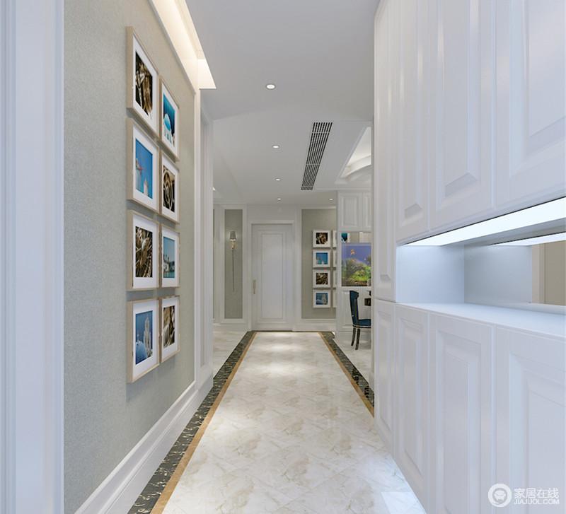 入户走廊上,灰色墙面被打造成文艺照片墙,与餐厅隔断的卧室走廊墙面相呼应;另一侧则以环绕型白色玄关柜设计,增加门厅存储功能;中间置物台内设灯带和镜面,让局部空间非常明快,便于快速选取置放物品。